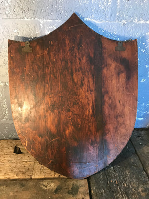 A large shield design bevelled Art Deco mirror