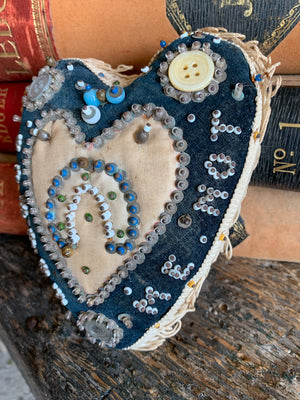 A First World War forget-me-not sweetheart pin cushion