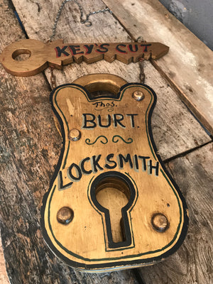 A Victorian style locksmith trade sign