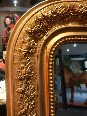 A large Louis Philippe mercury glass gilt overmantle arched French mirror
