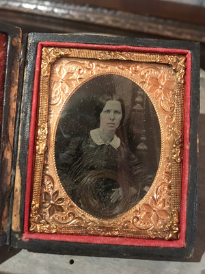 A 19th Century daguerreotype cased photograph of a lady with a lock of hair