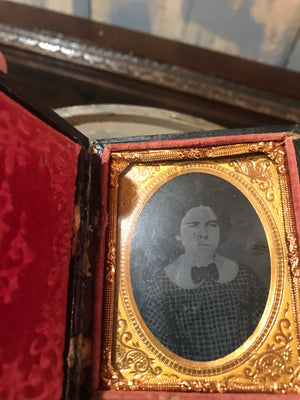 A 19th Century daguerreotype cased photograph of a young girl