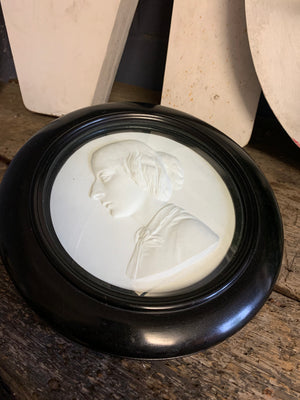 A 19th century bas relief plaster portrait of a lady