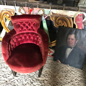A 19th century red velvet button back chair