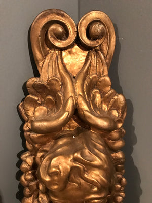 A gilt classical putto plaster wall plaque