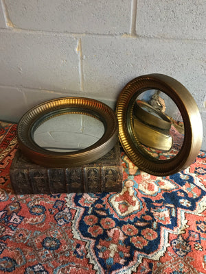 A rare pair of gilt convex ball mirrors