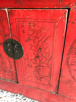 A large red Chinese temple chest