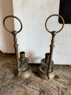 "A pair of brass ""Wee Willie Winkie"" style chambersticks"