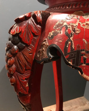 An Oriental red lacquer jardinière stand