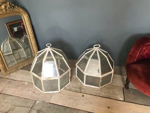 A pair of 19th Century cast iron garden cloches