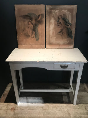 A slim white console table with single drawer
