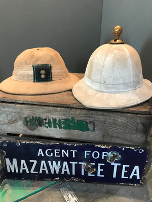 A Pair of Colonial Military Pith Helmets and Case