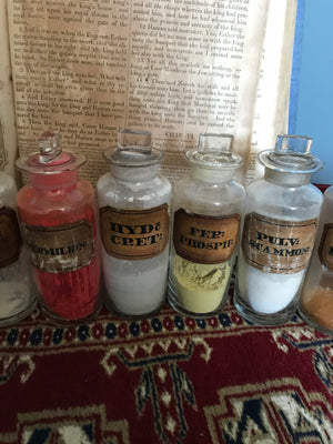 A set of 17 19th Century glass apothecary bottles or jars
