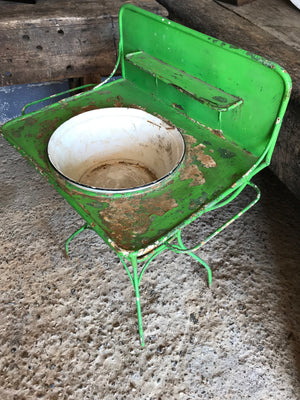 A shabby chic green metal wash stand with enamel basin