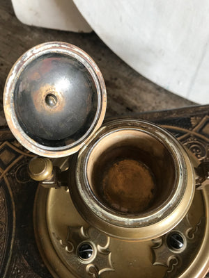 A bronze Gothic Revival agate inlaid inkwell and pen tray