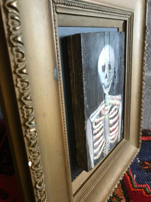 A small Memento Mori naive skeleton vanitas oil painting