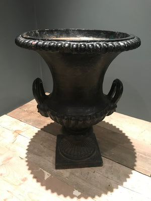 A 19th century black cast iron garden urn