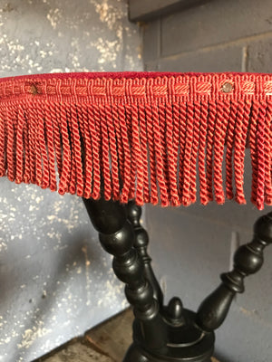 An early ebonised bobbin gypsy table with red velvet top