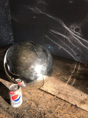 A very large silver mercury glass witches ball