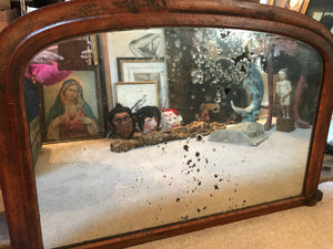A large inlaid arched overmantle mirror- heavily distressed