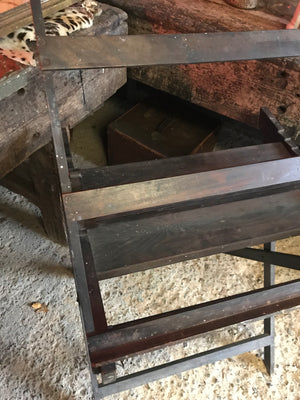 An unusual and rare wooden floor standing rack easel