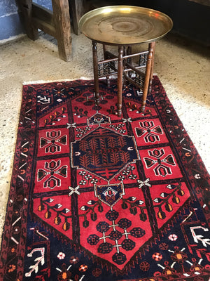 A Persian red and blue ground lozenge rectangular rug
