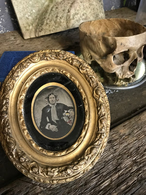 A hand tinted portrait Daguerreotype photograph in an oval gilt frame- large