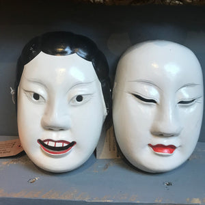 A carved wooden hand-painted Japanese noh mask