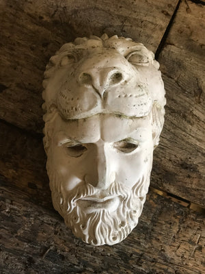 An old plaster head of Hercules wearing the Nemean lion skin