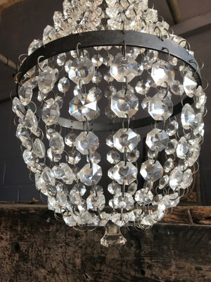 An Empire-style bag and tent crystal chandelier