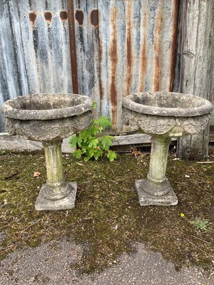 A pair of large stone classical urns
