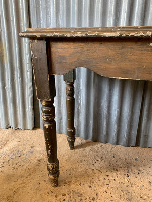A vintage rustic occasional table
