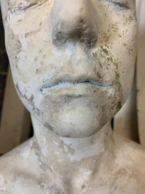 A life size bust in white plaster