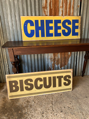 A pair of grocery shop advertising trade signs: cheese & biscuits