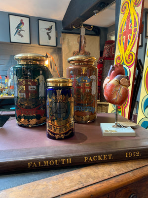 A set of three Royal Pharmaceutical Society apothecary jars