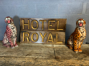 A large gilt lettered carved wooden 'Hotel' sign