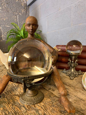 A fortune teller's crystal ball on a silver plated Art Nouveau stand