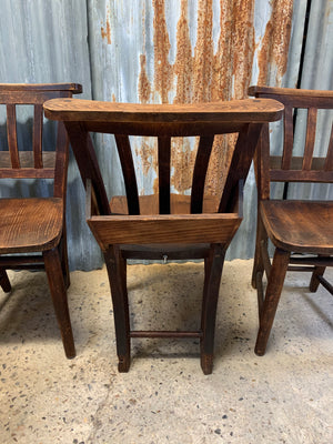 A set of 4 wooden 19th century chapel chairs