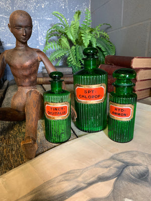 A rare set of three green glass apothecary jars