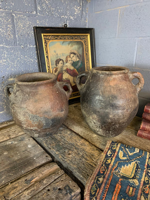 A large terracotta urn with double lug handles ~2
