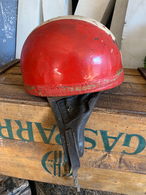 A red Cromwell pudding bowl motorbike helmet stamped BSA