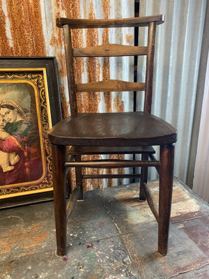 A set of four oak 19th Century chapel chairs