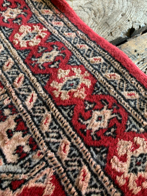 A hand woven Persian red ground rectangular rug
