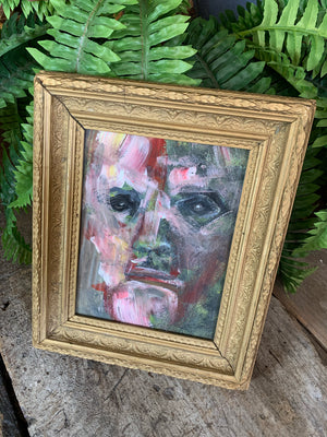 A framed expressionist portrait