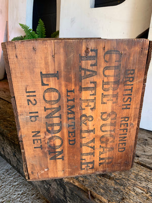 A stencilled Tate and Lyle sugar cube wooden advertising box