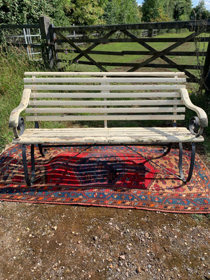 A 19th Century wrought iron and wood garden bench