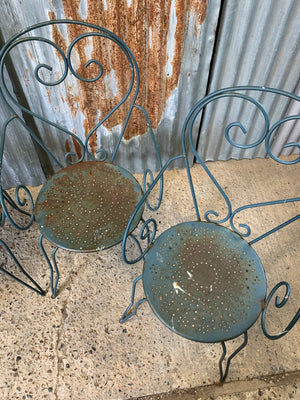 A set of four French blue wire work garden chairs