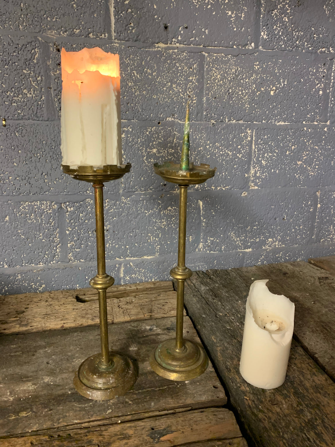 A large pair of tall Gothic church pricket candlesticks