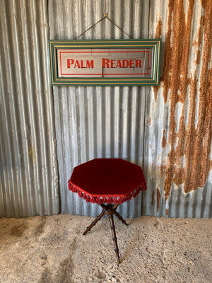A large Palm Reader fairground mirror