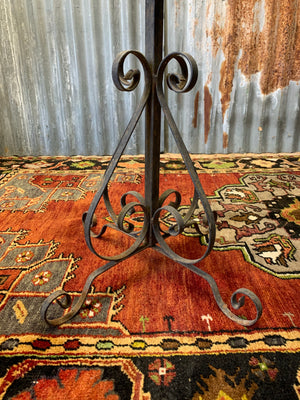 A black cast iron garden wine table or stand